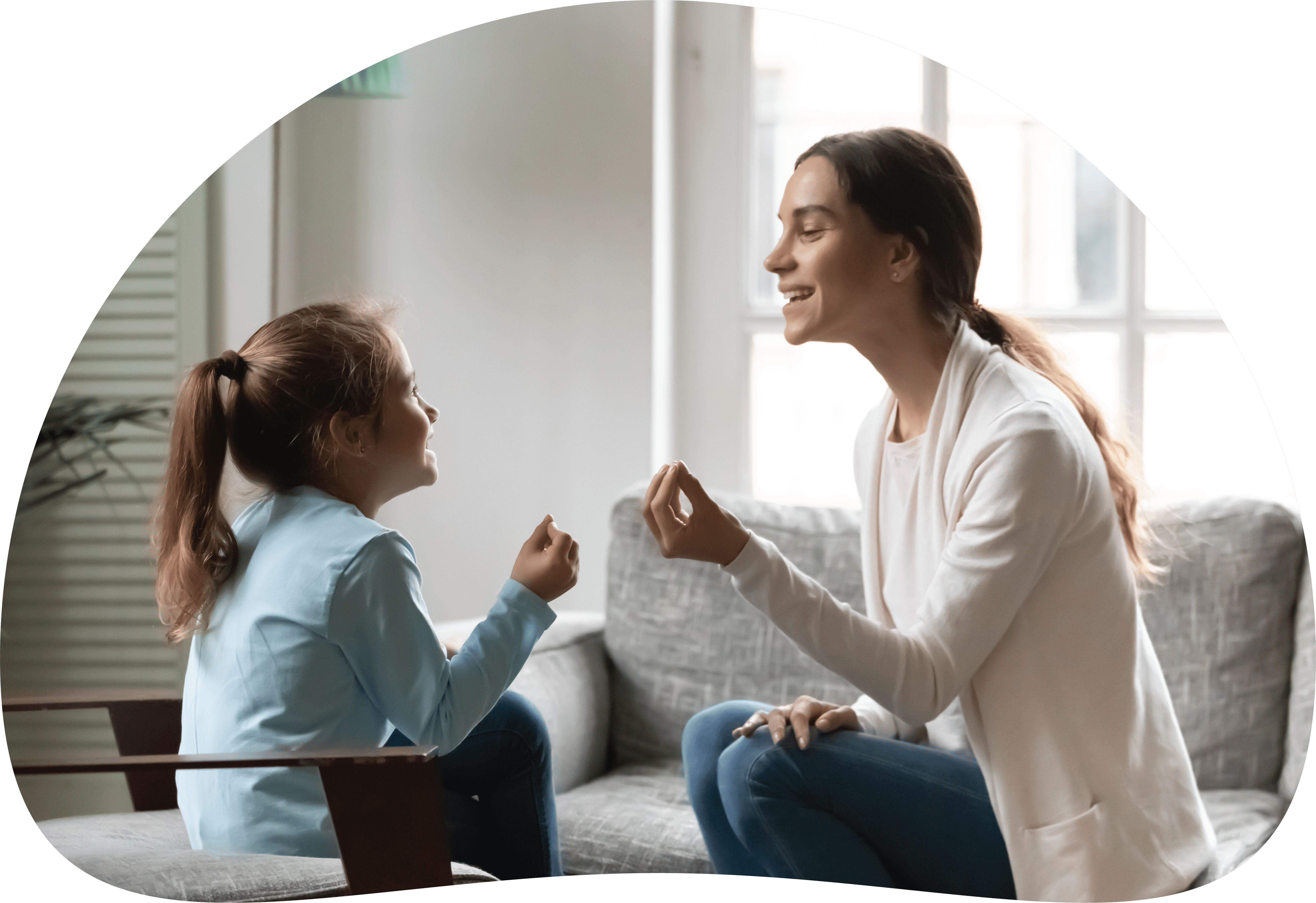 Woman and young girl learning together